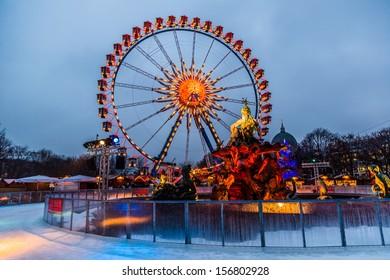 BERLIN,-DECEMBER 7:Berlin shines in a festive blaze of lights in the period before Christmas on December 7, 2012. Christmas wheel at Alexanderplatz in Berlin, Germany.