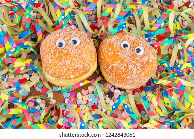 berliner, krapfen, food for carnival with funny eyes and streamers