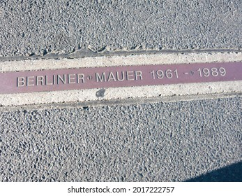 berliner mauer german text means Berlin wall place sign with dates 1961 to 1989 in germany west and east separation