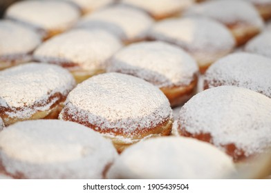 Berliner with powdered sugar on the sheet cake