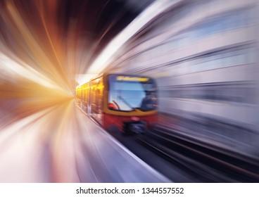The Berliner railway U-Bahn in motion at sunset. Germany.