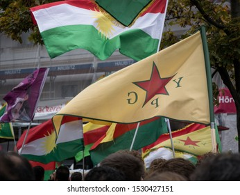 Berlin/Germany - 10/12/2019: Demostration and protest against Turkish offensive and aggressions in Syria against the Kurds, many kurdistan and ypg flags