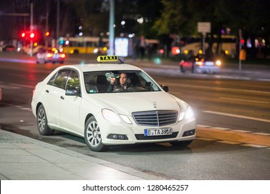 Berlin/Germany April 16, 2016  Beige taxi car Mercedes-Benz W212 E-class at the city street. - Image