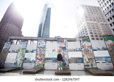 Berlin/Germany April 17, 2016 Fragment of the Wall of Berlin on exhibition in Potsdamer Platz. The Wall of Berlin divided the city between 1963 and 1989. - Image