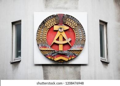 Berlin/Germany April 28, 2016 DDR shield in a building of the former Berlin under Soviet occupation in Berlin, Germany