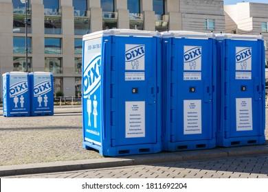 Berlin/Germany, August 06.2020: five Dixi rental toilets on the median