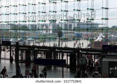 Berlin/Germany - August 10, 2019: looking towards the Reichstag through the glass facade of the central station