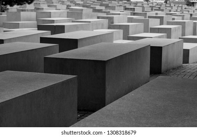 Berlin/Germany July 28 2017 - bunch of grey stone slabs of various sizes looking like graves in the center of Berling, Germany, symbolizing genocide of the Jews.Holocaust memorial of the fascist regim