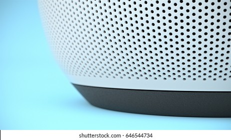 BERLIN,GERMANY - May 24 : Google home close-up on speaker area at the bottom on blue backdrop, the voice recognition streaming device utilizing Google Assistant from Google