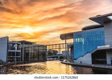 Berlin,Germany:06.10.2018: VIew of Berlin government district on Spree river passing famous Reichstag building and Paul Lobe Haus on at sunset, Berlin Mitte, Germany