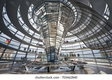 BERLIN-SEPTEMBER 5: Large glass dome of The Reichstag or Deutscher Bundestag. The main hall can be seen from inside the dome, as a symbol of transparency. September 5 2016 in Berlin, Germany