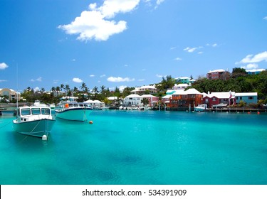 Bermuda, British Overseas Territory - November 26, 2008: tropical bay or harbor beach of turquoise sea with modern yachts marine boats vessels at moorage on sunny day on blue sky