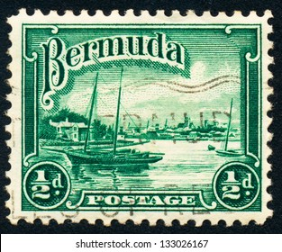 """BERMUDA - CIRCA 1936: A stamp printed in Bermuda shows Port of Hamilton and sailing """"Song of the Wind"""", circa 1936"""