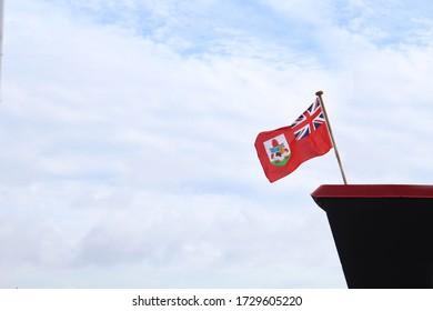 Bermuda flag flying on a boat.