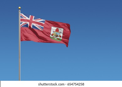 Bermuda Flag in front of a clear blue sky