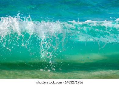BERMUDA - November 2018: Breaking wave on an empty beach.