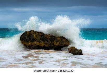 BERMUDA - November 2018: Wave splashing off a rock on the coast of the Atlantic.