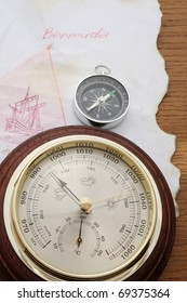 The Bermuda Triangle on old chart of America, compass and barometer
