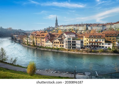 Bern city Skyline with Aare river and Bern Minster Cathedral tower on background - Bern, Switzerland