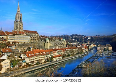 BERN CITY, SWITZERLAND- December 15, 2016. View of the Old Town (Altstadt) of Bern and river Aare with the Bell Tower of the Münster (cathedral) standing out.