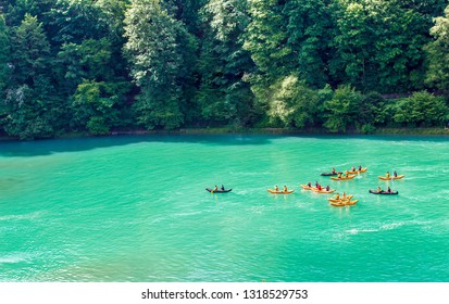 Bern, Switzerland - 05/11/2018: Kayaks on the river Aare. Rafting on the river Aare. Swimmers in Bern