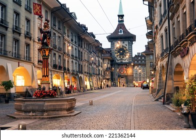 Bern, Switzerland - 17 September 2013: People on the shopping alley with the famous clocktower of Bern on Switzerland