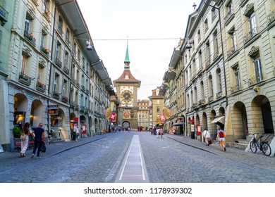 Bern, Switzerland - 23 AUG 2018: People on the shopping alley with the Zytglogge astronomical clock tower of Bern in Switzerland.