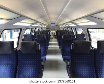 Bern, Switzerland 24 4 2019: Empty bls train with blue seats.