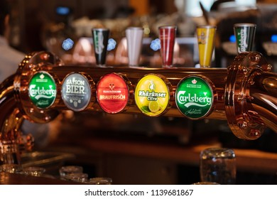 Bern, Switzerland - APRIL 27: View of Various kind of brand of beer tab in the bar on April 27,2018