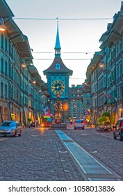 Bern, Switzerland - August 21, 2013: Zytglogge clock tower on Kramgasse street with shopping area in old city center of Bern, Switzerland in the evening