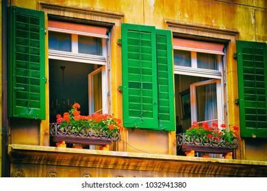 Bern, Switzerland - August 31, 2016: Windows with green shutters of the building on Kramgasse street in Bern, in Switzerland