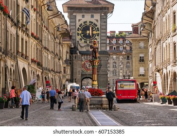 Bern, Switzerland - August 31, 2016: People at Zahringen fountain and Zytglogge clock tower on Kramgasse street with shopping area in old city center of Bern, Switzerland