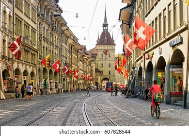 Bern, Switzerland - August 31, 2016: People at Kafigturm tower in Marktgasse street with shopping area in old city center of Bern, Switzerland