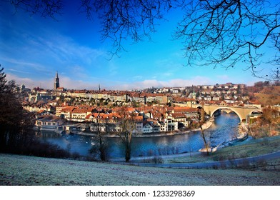 """BERN, SWITZERLAND - December 15, 2016. View of the Old Town (""""Altstadt"""") of Bern, from the other side of Aare river."""
