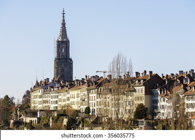 BERN, SWITZERLAND - DECEMBER 26, 2015: The medieval city center of Bern seen in the distance. The Capital City of Switzerland it is the 4th most populous city in Switzerland