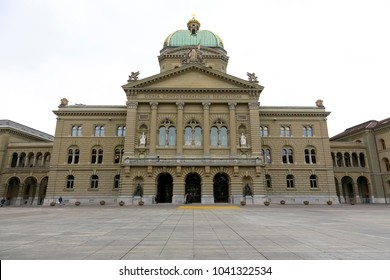 Bern, Switzerland - February 21, 2018: The Federal Palace, it is the seat of Swiss Federal Assembly. The building is shown from the side of the city square, which is usually crowded but now not.