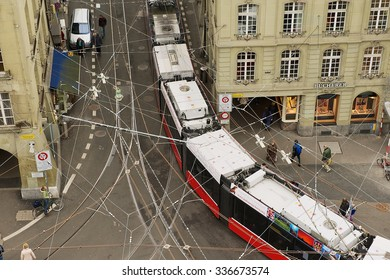 BERN, SWITZERLAND - FEBRUARY 23, 2012: View from the Clock Tower to the tram passing by the street in Bern, Switzerland.