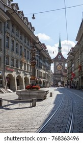 Bern, Switzerland - July 22nd, 2017 : Shopping street in the old medieval city of Bern, Switzerland. In 1983 the historic old town in the centre of Bern, Switzerland became a UNESCO World Heritage Sit
