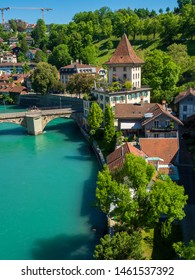 Bern, Switzerland - Jun 2nd 2019: The Aare river flows around three sides of the city of Bern. With its crystal-clear turquoise water