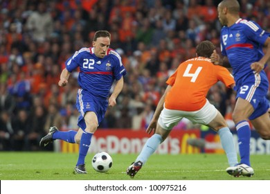 BERN, SWITZERLAND - JUNE 13:  Franck Ribery of France drives the ball during a Euro 2008 match against the Netherlands June 13, 2008 in Bern, Switzerland.  Editorial use only.