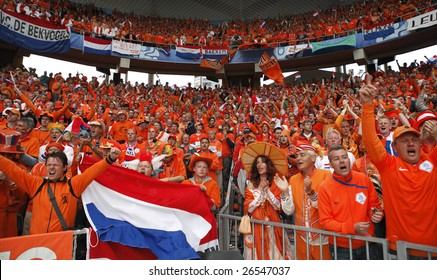 BERN, SWITZERLAND - JUNE 13:  Supporters cheer after a Holland goal during the Netherlands' 4-1 rout of France in a UEFA Euro 2008 Group C match June 13, 2008 in Bern, Switzerland.