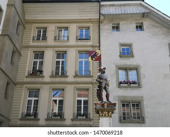 Bern, Switzerland - June 2, 2019:  The Vennerbrunnen (Brunnen Fountain) stands on the town hall square in Bern and is one of the Bernese old town fountain from the 16th century.