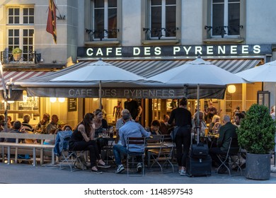 Bern / Switzerland - June 5 2018: The Cafe Pyrennes in Bern with people enjoying chat and drinks in the evening