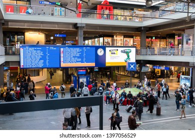 Bern, Switzerland - March 30, 2019 : Train schedule in bern main train station, showing long distance departure times to other Swiss cities and metro trains on an information board.