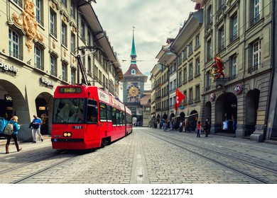 Bern, Switzerland - May 10, 2016 : Shopping street in the old medieval city of Bern, Switzerland. In 1983 the historic old town in the centre of Bern, Switzerland became a UNESCO World Heritage Site