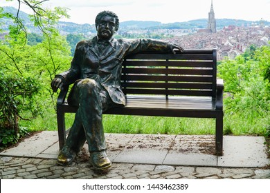 """Bern ,Switzerland - May 2018 : This is statue of scientist """"Albert Einstein"""" in the RosenGarten park. He lived in Bern between 1902 and 1909, and wrote the famous formula of his in this city."""