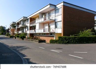 Bern, Switzerland - September 23, 2017: Two-storey residential houses are visible next to the street where there is no traffic. This is in the district on the outskirts of the city.