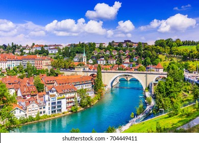 Bern, Switzerland. View of the old city center and Nydeggbrucke bridge over river Aare.