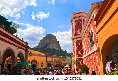 Bernal, Querétaro / Mexico - June 11, 2017  Tourists in streets below the Peña de Bernal, a 1400 foot tall monolith.
