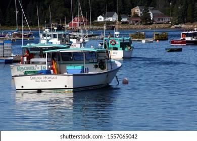 BERNARD, MAINE - SEP 1, 2006 -Lobster traps on wharf and lobster boats in harbor, Mount Desert Island, Acadia National Park,Bernard Maine, New England